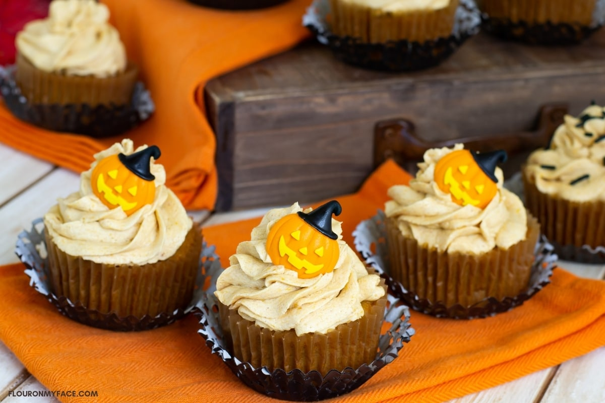Halloween decorated pumpkin cupcakes with Pumpkin Spice Buttercream Frosting