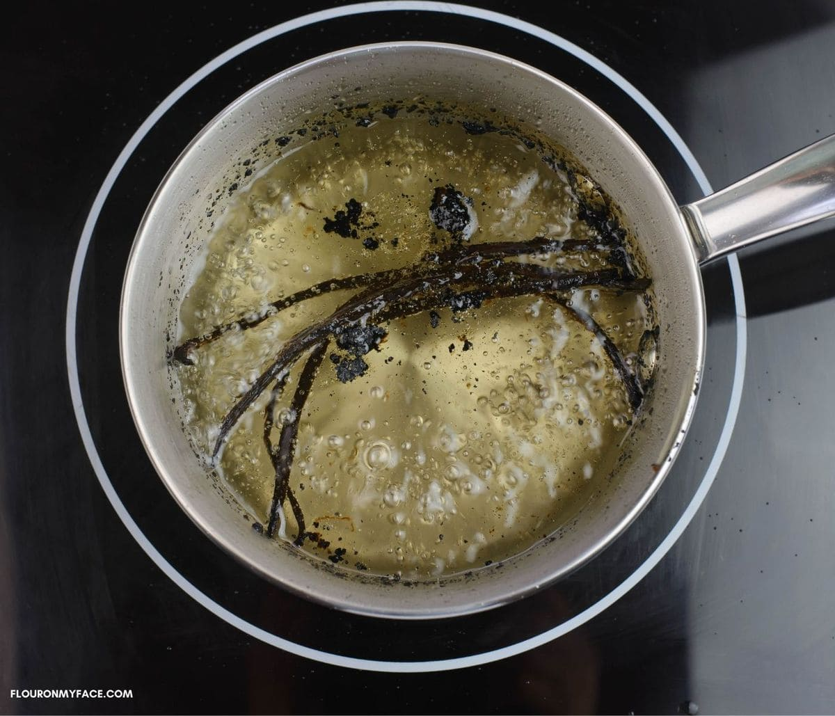 Vanilla bean syrup in a small pan  simmering on a burn.