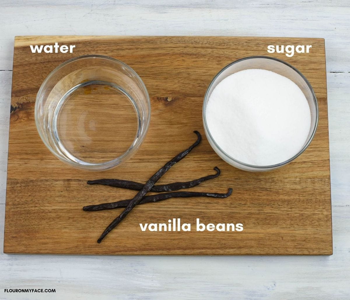 Vanilla syrup ingredients on a wooden cutting board.