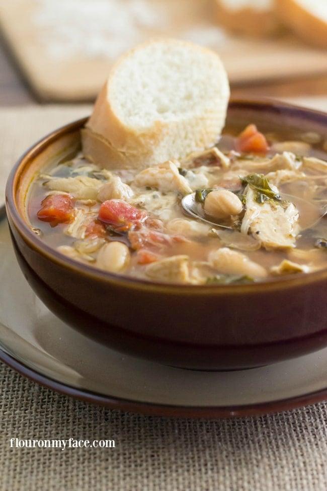 Crock Pot Tuscan Chicken Soup recipe via flouronmyface.com #CrockPotFriday