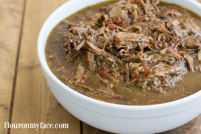 Easy Crock Pot SHredded Beef is perfect for beef tacos, enchiladas, beef nachos and beef quesadillas via flouronmyface.com
