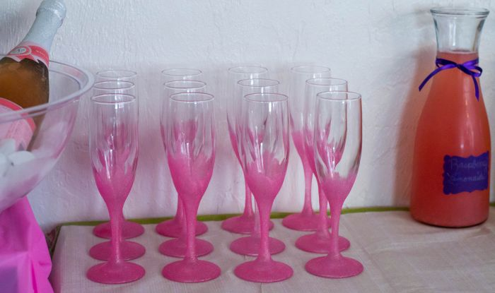 Easy decorated champagne flutes for a DIY Mimosa Bar via flouronmyface.com
