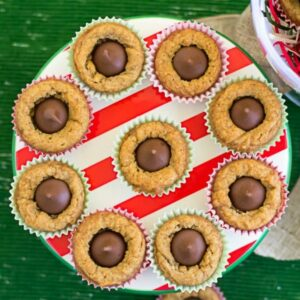 Peanut Butter Blossum Cookies on a holiday cake stand.