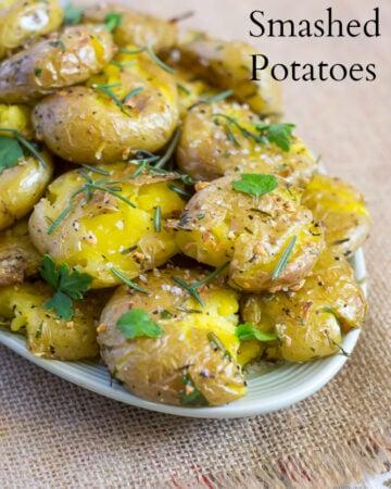 Golden roasted Garlic Rosemary Smashed Potatoes recipe via flouronmyface.com