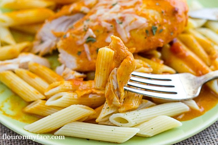 Crock Pot Chicken in Vodka Sauce served over Penne Pasta via flouronmyface
