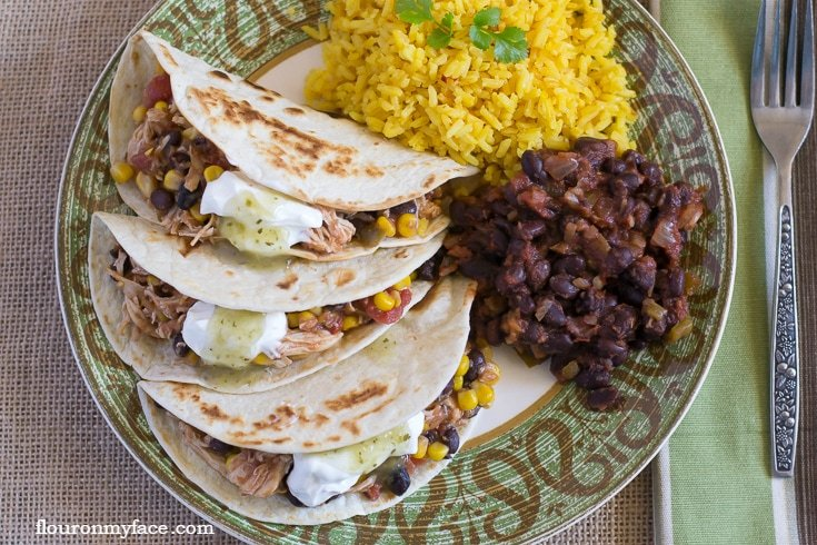 Easy Crock Pot Salsa Chicken served on tortillas on a plate
