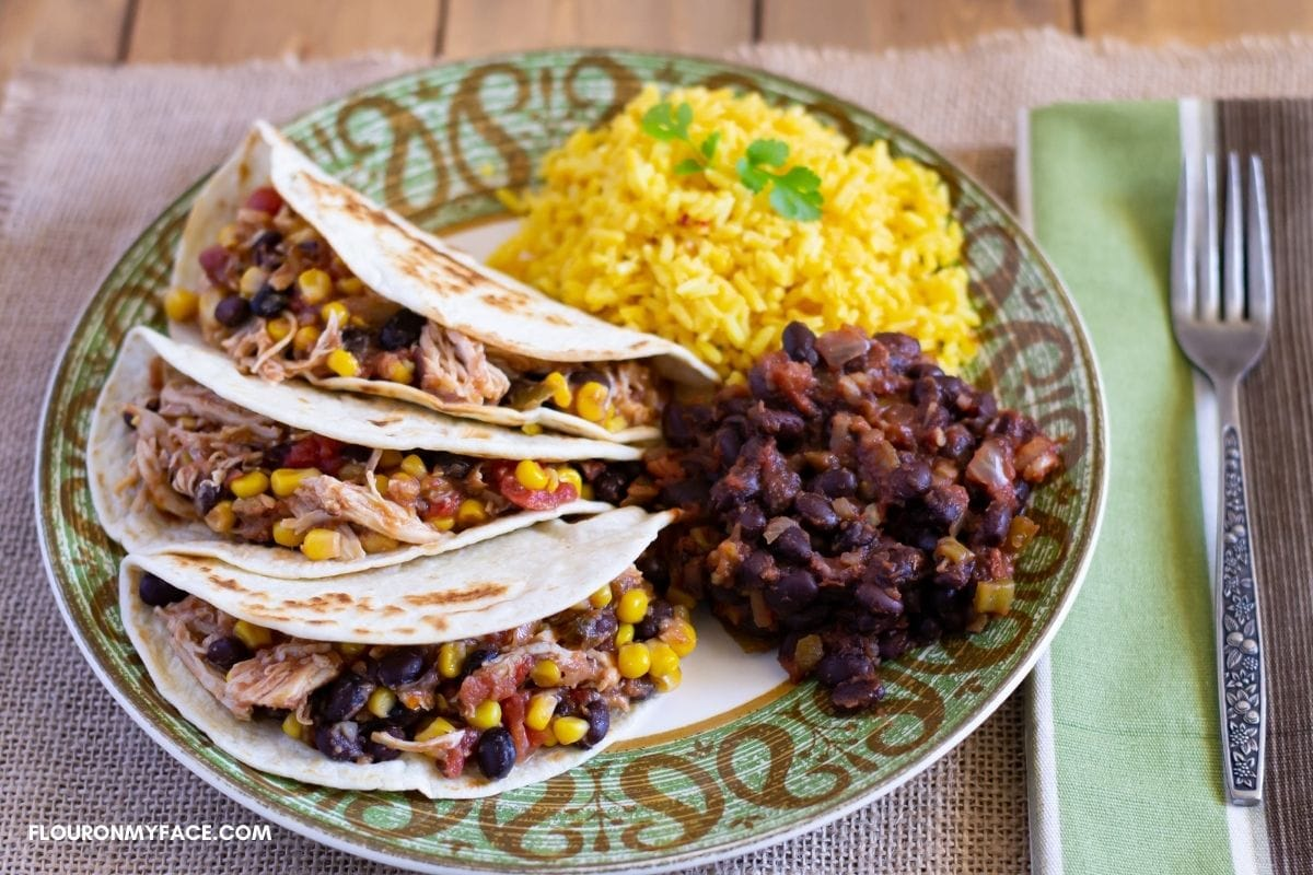 Serving chicken salsa with rice and beans.
