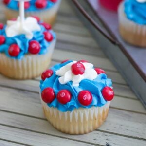 Red, white and blue Captain America Cupcakes on a table..