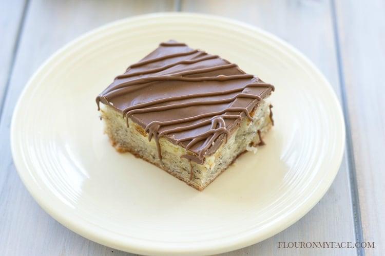A slice of homemade banana bread cheese cake bars via flouronmyface.com