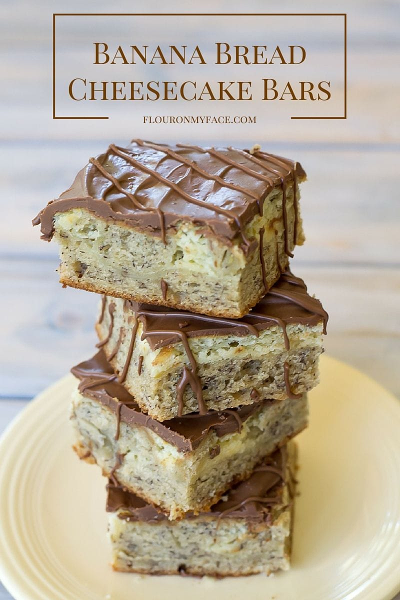 Banana Bread Cheesecake Bars is the best of two worlds-Banana Bread with a cheesecake layer topped with chocolate. You can't go wrong with this sweet dessert bar recipe via flouronmyface.com