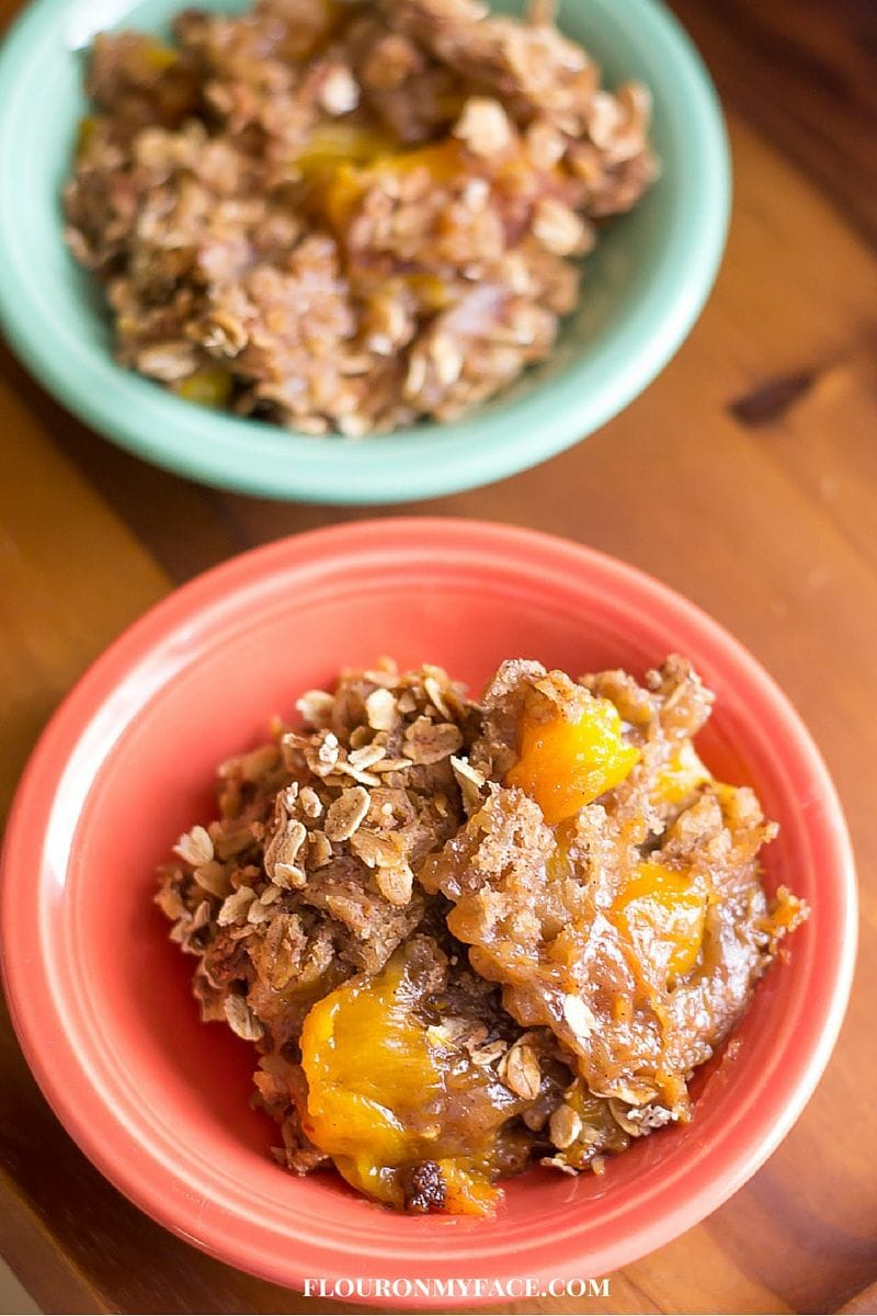 Crockpot Peach Crunch Cake recipe via flouronmyface.com is perfect for a Sunday morning brunch.