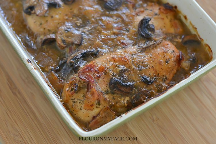 Crock Pot Chicken Marsala recipe in a servong dish after it has been lightly browned under the broiler via flouronmyface.com