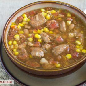 Bowl of Crock Pot Southwestern Pork stew via flouronmyface.com