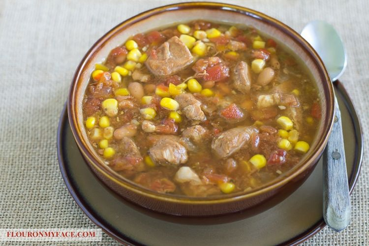 Bowl of Crock Pot Southwestern Pork stew via flouronmyface.com