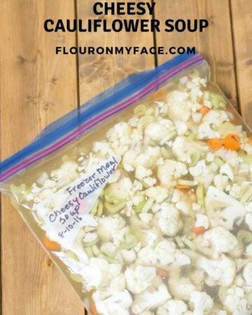 Freezer Meal Cheesy Cauliflower Soup recipe via flouronmyface.com