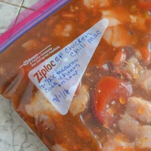 Freezer Meal Crock Pot Chicken Chili Mac ingredients in a freezer bag.
