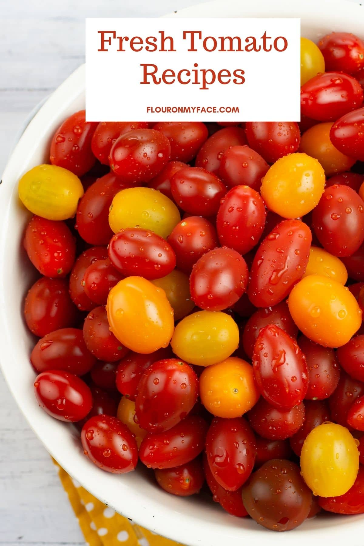 A Colander filled with cherry tomatoes.