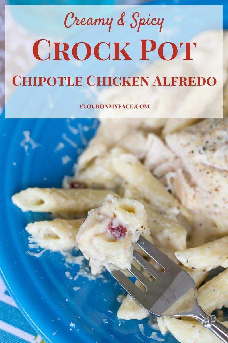 Creamy and Spicy Crock Pot Chipotle Chicken Alfredo recipe with homemade alfredo sauce via flouronmyface.com