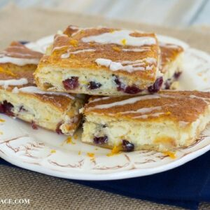 Holiday recipes using Crescent rolls- Cranberry Orange Cheesecake Bars via flouronmyface.com #ad