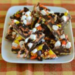 Halloween Cookie Bark pieces on a white plate.