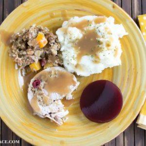 Apple Cranberry Butternut Squash stuffed pork loin recipe via flouronmyface.com #ad #crockpotrecipe