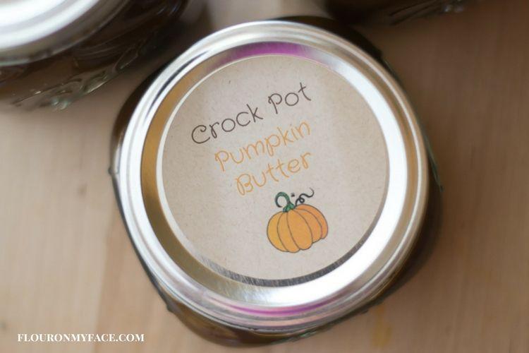 Crock Pot Pumpkin Butter in mason jars with a free printable Pumpkin Butter label via flouronmyface.com