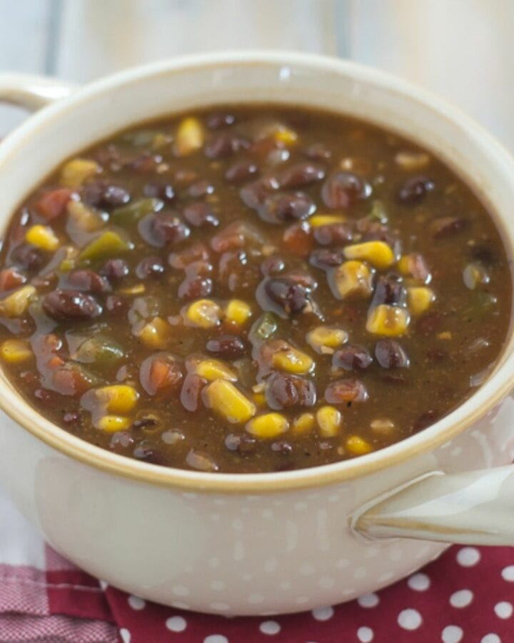 Black Bean and Corn Soup served in a white soup bowl with handles.