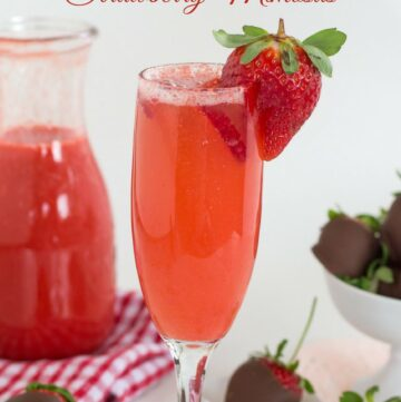 Fresh Strawberry Mimosas recipe is the perfect way to surprise your sweetheart on Valentines Day. Serve him or her a tray with chocolate covered strawberries and this Strawberry Mimosas recipe for breakfast or brunch