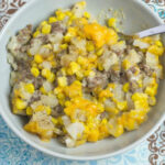 Crock Pot Cowboy Casserole recipe served in a grey bowl