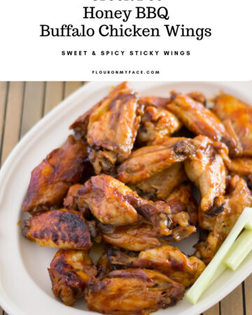 Crock Pot Honey BBQ Buffalo Chicken Wings recipe served on a platter with homemade ranch dressing.