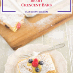 Cheesecake Lemon Curd Berry Crescent Bar served with berries on a plate.
