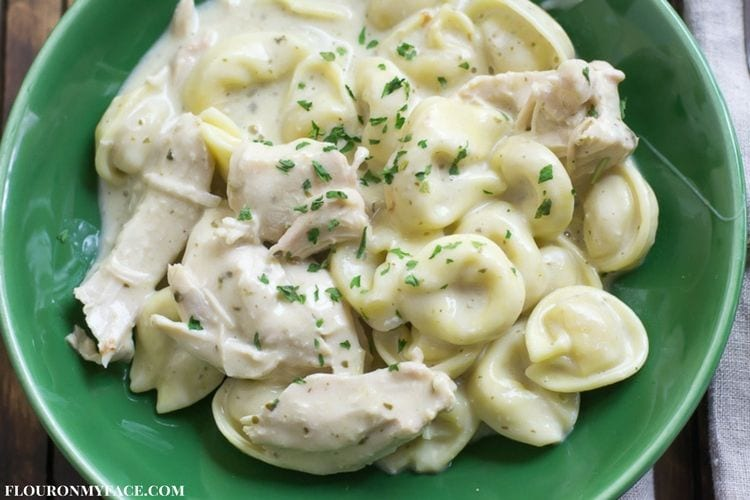 Easy Chicken Alfredo Tortellini made in a slow cooker. Fats, delicious and ready to serve up in no time.