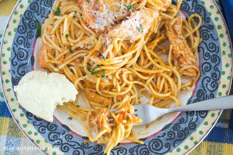 Crock Pot Chicken Spaghetti recipe is a delicious family dinner recipe that needs to be included in your weekly menu planning via flouronmyface