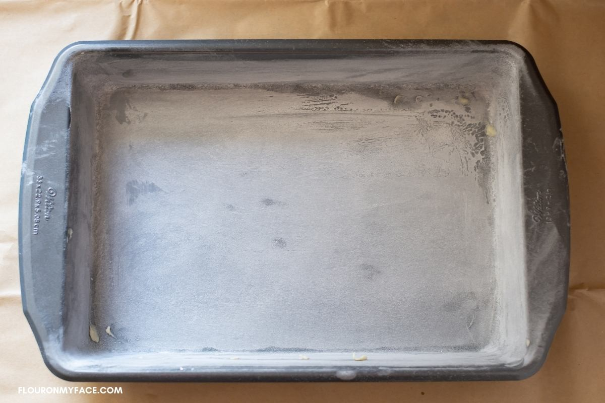 A greased and floured rectangle cake pan.