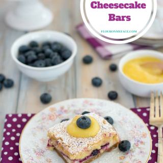 Fresh Blueberry Cheesecake Bars recipe made with a fresh blueberry filling, homemade cheesecake filling and a cake layer made fluffly by using a combination of flours.