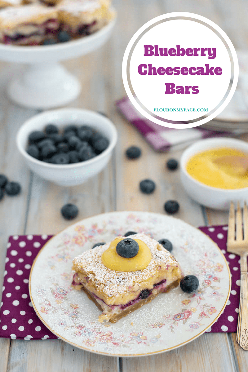 Fresh Blueberry Cheesecake Bars recipe made with a fresh blueberry filling, homemade cheesecake filling and a delicious cake layer made fluffy by using a combination of flours.
