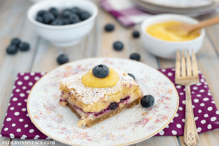 Fresh Blueberry Cheesecake Bars recipe topped with homemade lemon curd and Florida blueberries #ad