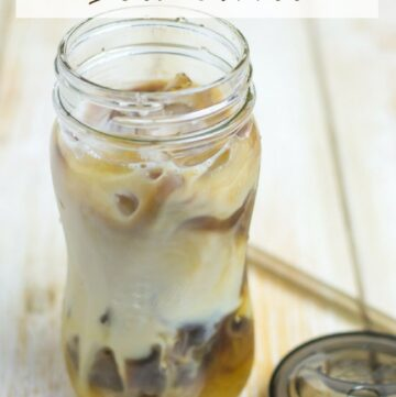 Cold Brewed Iced Coffee in a mason jar with a lid and straw.