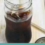 a glass of cold brewed iced coffee poured over ice.