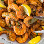 A serving platter piled high with New Orleans Style Barbecue Shrimp