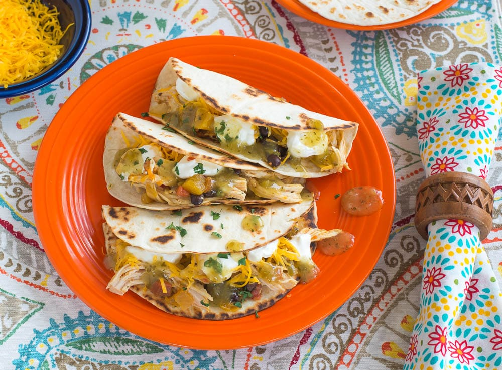 Instant Pot Mango Salsa served on warm tortilla's with shredded cheese, sour crean and salsa verde via flouronmyface.com