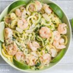 2 Ingredient Shrimp Scampi recipe made with SeaPak Shrimp Scampi and fresh zucchini and yelolow squash zoodles, in a green bowl via flouronmyface.com #ad