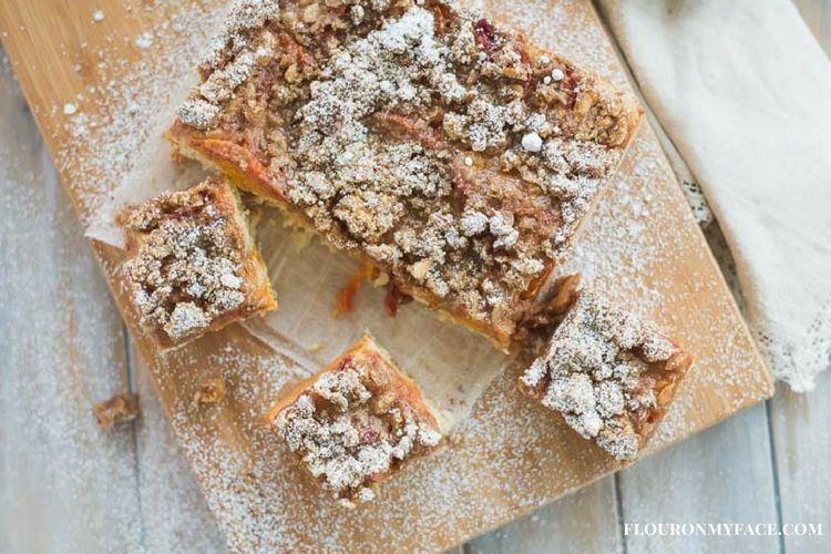 Homemade Apricot Crumb Cake Recipe on a wooden cutting board via flouronmyface.com