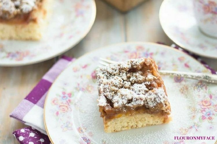 Apricot Struesel Crumb Cake slice on a vintage floral plate. via flouronmyface.com