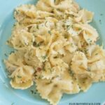 Crock Pot Chicken Alfredo Pasta Casserole recipe on a blue plate via flouronmyface.com