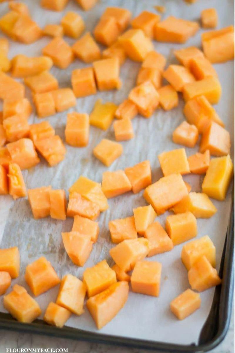 Cubes of fresh Papaya ready for the freezer via flouronmyface.com