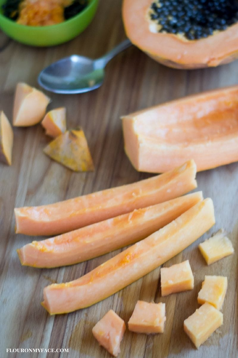 Fresh papaya sliced and cubed before freezing via flouronmyface.com