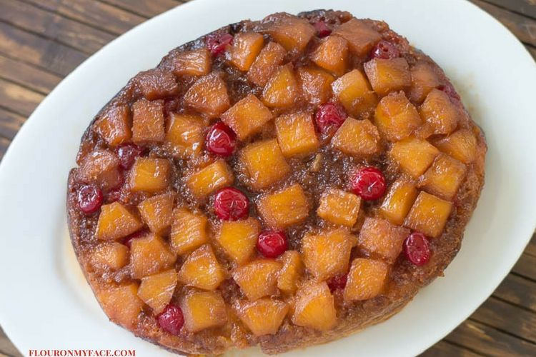 Perfect Plated Crock Pot Pineapple Upside Down Cake on a white platter