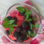 Sangria fruit in a glass pitcher before adding the wine via flouronmyface