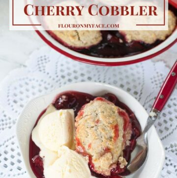 Old Fashioned Cherry Cobbler recipe just like Grandma made served in an enamel pan topped with homemade biscuit topping